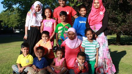 Afsar Chaudhury, middle back row, with the 12 children who will be helping to raise money for charit