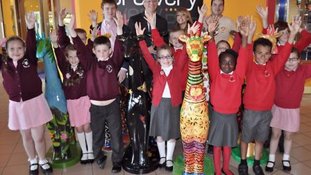 Children from RJ Mitchell School and Pinewood School with the giraffes they designed.