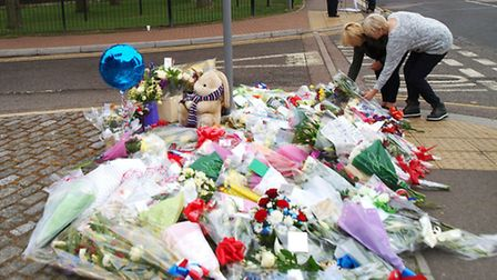 Floral tributes being laid outside Woolwich barracks. Charity Help for Heroes' website has crashed a