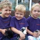 Luke Springfield, Callum Attwood-Kelly and Amber Stannard holding baby rabbits.