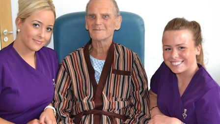 Patient Ronald Payne who enjoyed his pampering, is pictured with students Jacqueline Webster and Til