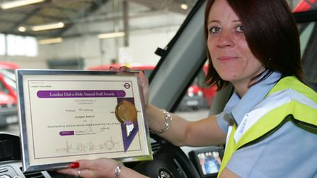 Dial-a-Ride driver Noreen Minihane with her award