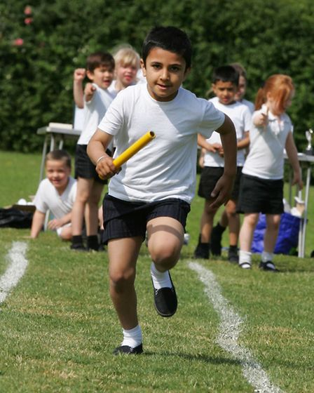 Navpreet Mann completing a relay race at Nelmes Primary School's sports day.