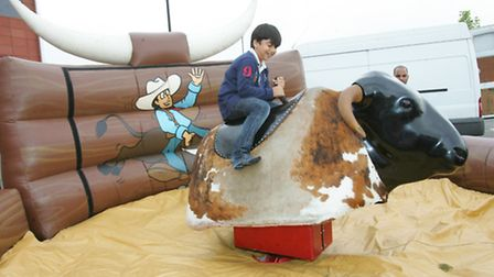 Youngster on the bucking bronco.