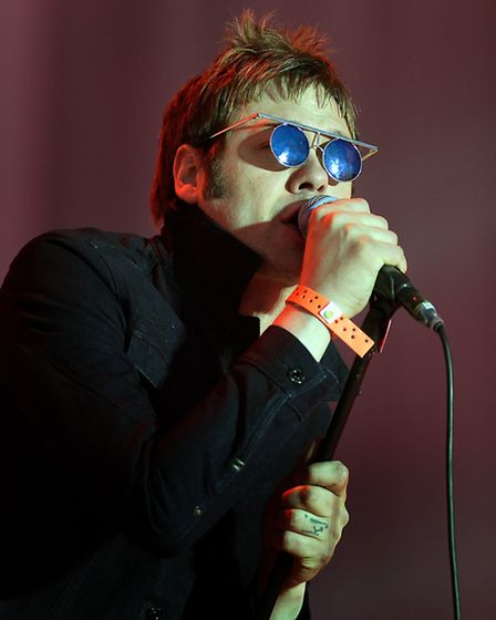 Tom Meighan of Kasabian performs on stage at the Hard Rock calling music festival at Queen Elizabeth