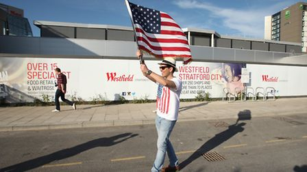 New Yorker John Matheson waves an American flag on his way to the Bruce Springsteen concert