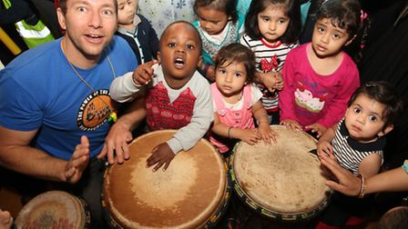 Toddlers of Plaistow Day Nursery have a go in a drum jam session at Cleves Primary School.