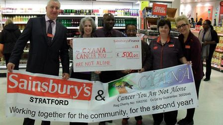 Stratford Sainsbury's staff hand over a cheque for £500 to Cancer You Are Not Alone (CYANA).
