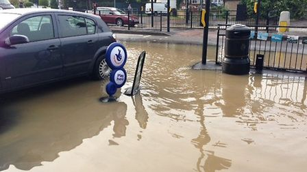 The scene outside the Bridge Convenience Store after a water pipe burst