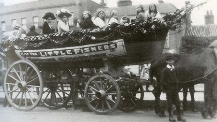 The little fishers with their minders in a horse-drawn boat. Picture: Brian Evans