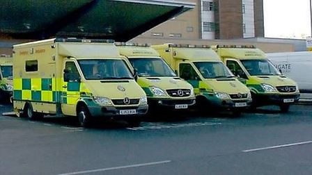Ambulance queue up outside Queen's Hospital A&E. Picture by Sandra Rowse