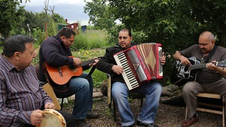 World Music Day at Forest Farms peace garden saw Roma band Just5 playing accordion, guitar, double