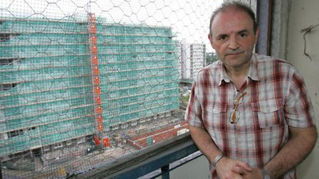 Orchard Estate resident John Gallagher on his balcony