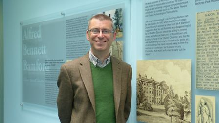 Cllr Andrew Curtin with the permanent display at Central Library, Romford.