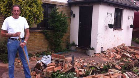 Ray Hayes confronts the debris outside his home in Clayhall Avenue