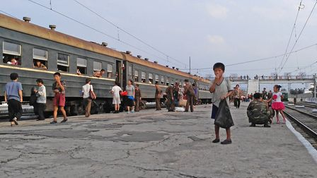 HAMHUNG, NORTH KOREA - AUGUST 21: A little boy begs for food on the platform in Hamhung Railway Sta