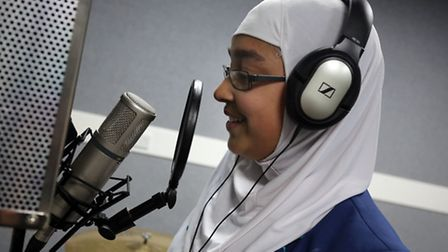 Inayah Aslam, 12, in the recording studio at Loxford Youth Centre