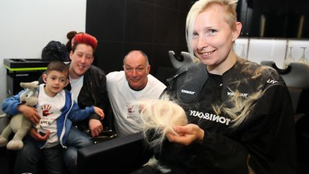 Lisa Terry, right, with Oliver Smith and his parents Natalie and Thomas Oliver while she gets her he