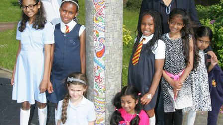 Artist Gary Drostle, Wilson Chowdhry and school kids at the unveiling of the mosaics