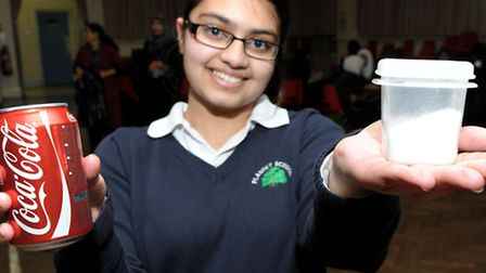 Plashet School pupil Anam Alam, 13, shows the ammount of sugar in a fizzy drink