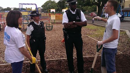 Community police team officers talk to volunteers from the City Gates Christian Centre.