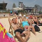 Sunbathers at the Royal Victoria Beach in Royal Victoria Docks.