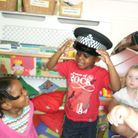 Nathi tries out police hat as officers visit Chestnut Nursery
