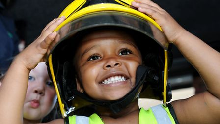 Shanai Lee Bright in a fire engine