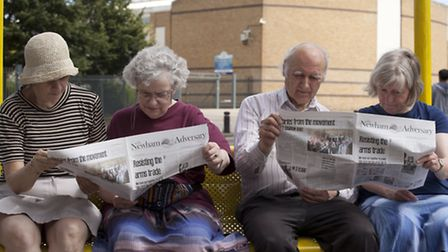 Activists from Campaign Against the Arms Trade read their campaigning newspaper called Newham Advers