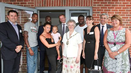 Members of Redbridge Council and East Thames staff visit with residents at their new home