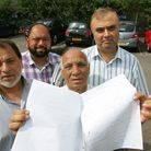 Zahid Butt, Mohammed Ashraf, Ali Younis and Mohammed Butt with the 500 signature petition