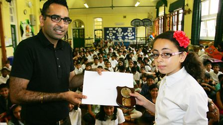 Lemar Mohamad receives her award from headteacher Kulvarn Atwal