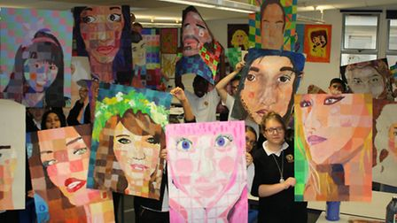 Year Nines at Forest Gate Community School with their mock GCSE art work.