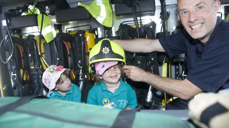 Evie Nathan, 2, Evie Kaplan-Lachs, 3 and firefighter Peter Chatten-Berry