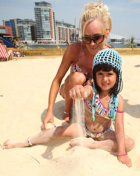 Daria Aslam, four, with her mum Dovile Gecaite, play at the Royal Victoria Beach at Royal Victoria D
