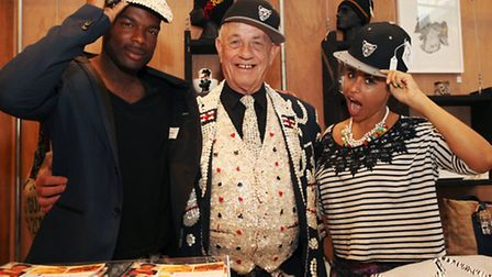 Pearly King of Mile End John Scott with cap designer Ricardo Roach,left, and Chi Gavhure at the Esta