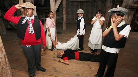 """Year three children of Old Palace Primary School,Bow, perform """"People in the mill"""" at the Three Mill"""