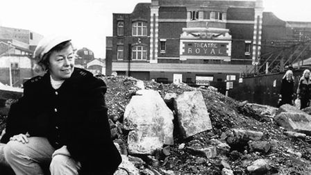 """""""Oh What a Lovely War!"""" director Joan Littlewood sitting on rubble outside the Theatre Royal Stratfo"""