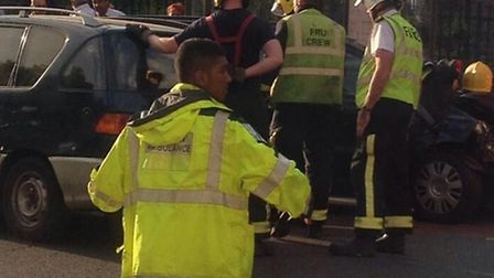 Fire crews arrive to separate the cars but the young man carries on directing traffic around the inc