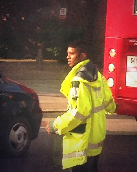 Paramedics give the young man a jacket to make sure he's safe while directing traffic. Picture: Fara