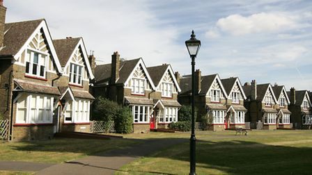 Some cottages and the green at Barnardo's Village, as it is today