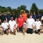 Chris Gregory, centre, taught Palmer Catholic Academy students how to play beach volleyball at Loxfo