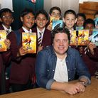 Mark Walden with Year 7 pupils at Ilford County High