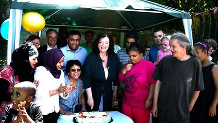 MP Lyn Brown cuts the cake at the first anniversary bash for the Urban Wilderness garden