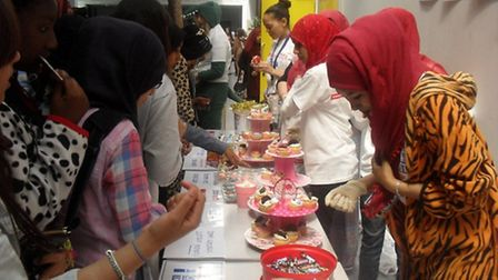 Sarah Bonnell School pupils selling cakes in aid of Teenage Cancer Trust.