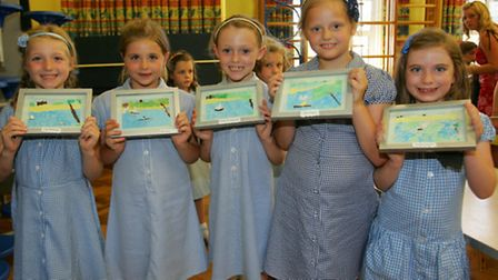 Pupils from Upminster infant school with their work