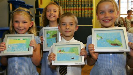 Pupils from Upminster infant school with their art