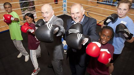 Barry McGuigan and London Legacy Corpoation Chief Executive Dennis Hone,centre, with youngsters at t