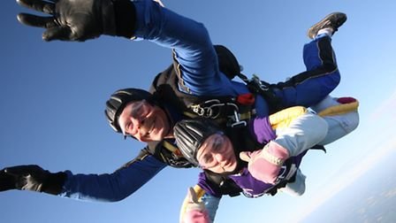 Maxine Davies, alongside an instructor, taking part in the skydive.