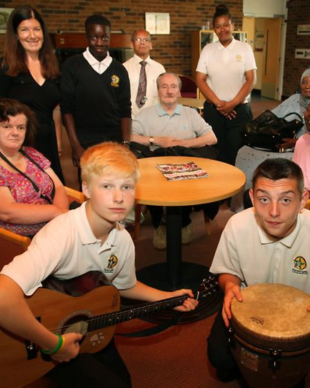 Forest Gate Community School students perform for the Newham Stroke Club at the Newham Resource Cent